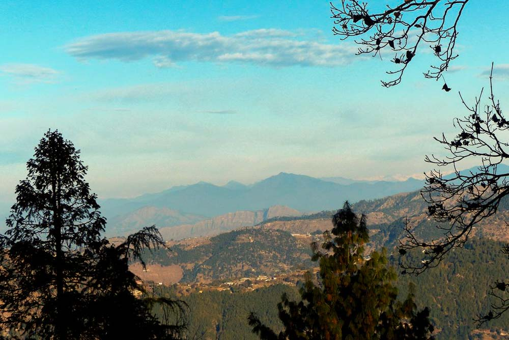 The view from Maisonette Firhill in Murree. The snow capped Himalayan Mountains are in the distance.