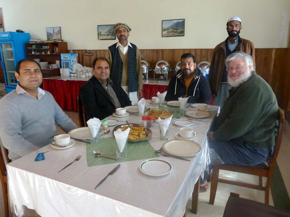 Breakfast at our PTDC Hotel in Balakot: Ehsan, Yousaf, Afaq and Doug Horst with hotel staff in the background.