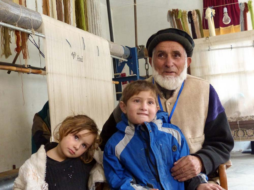 Ghullam Mohammad with his grandkids at the new Jared Training Center.