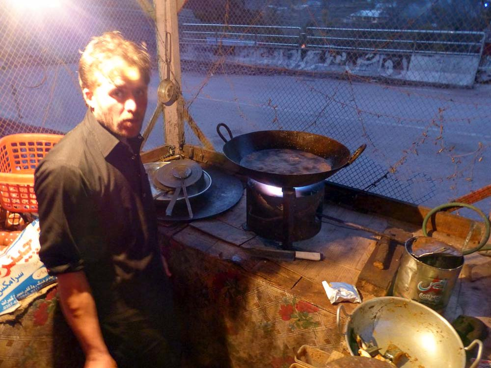 Our cook deep frying our trout supper.