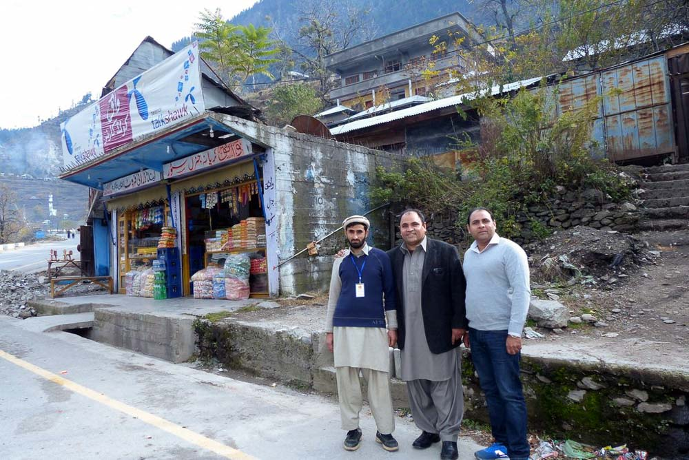 Ghullam Rehman, Yousaf and Ehsan standing near the spot in Jared where Ehsan's vehicle broke down in 1997. The new Bunyaad Training Center is just above them.