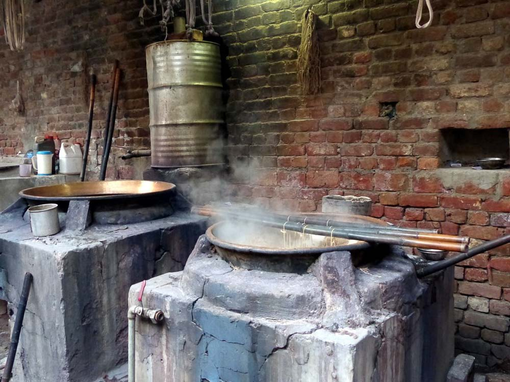 Copper dye baths in Anayat's workshop.