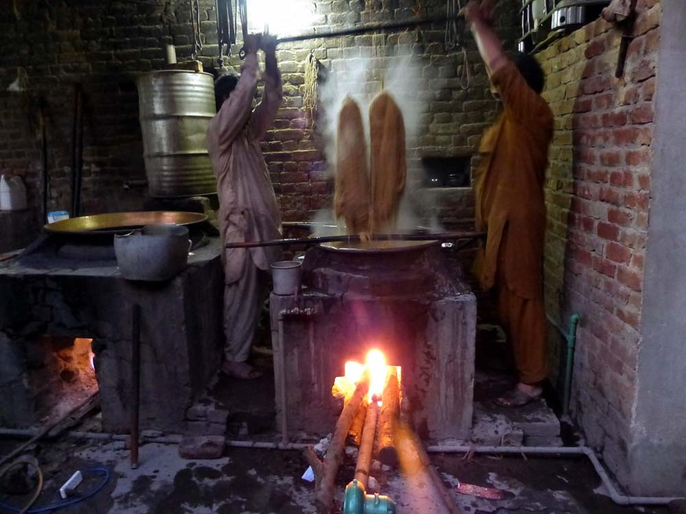 a wood fired vat in Anayat's workshop
