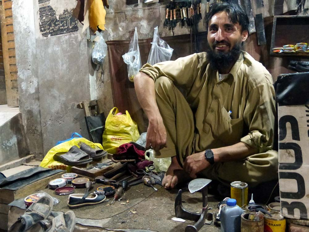 Shoe repair man in the alley near Bunyaad.
