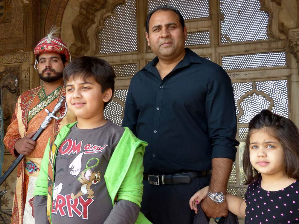 Ehsan and his kids, Shamil and Zara. Actor dressed in Mughal era dress is in back.