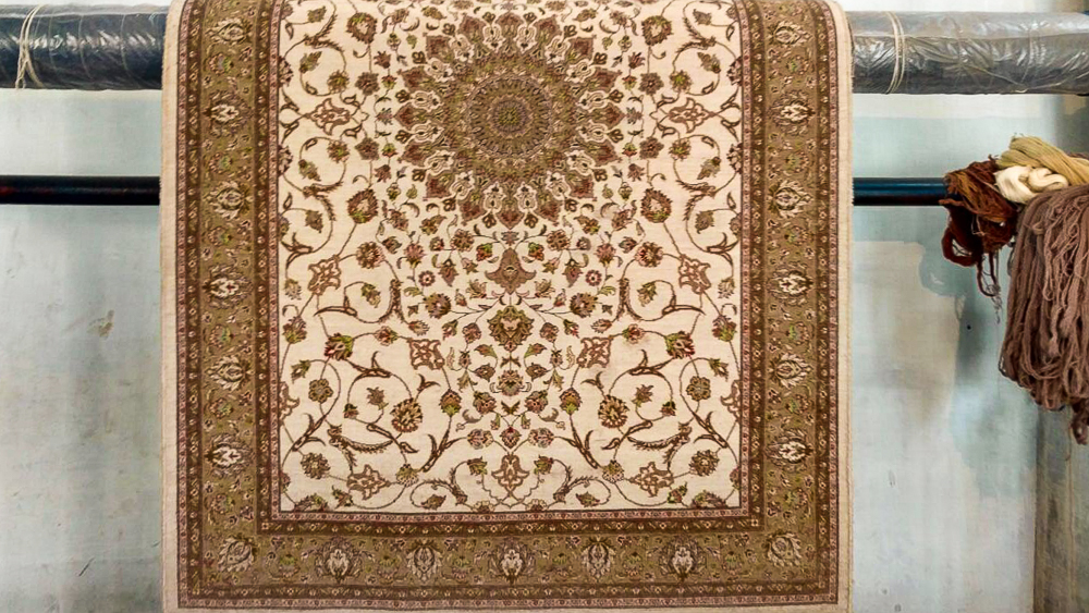 The finished rug is a 4'x6' Persian rug with over 500 knots per square inch but it's so much more.