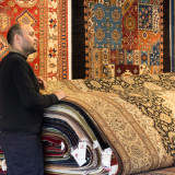 Amir explains bunyaad rugs.