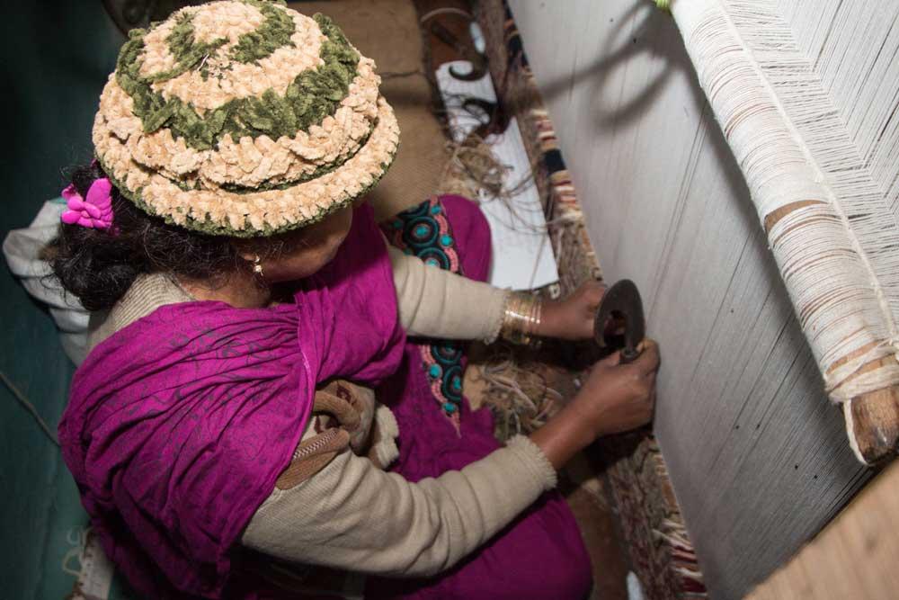 Fauzia knotting the rug