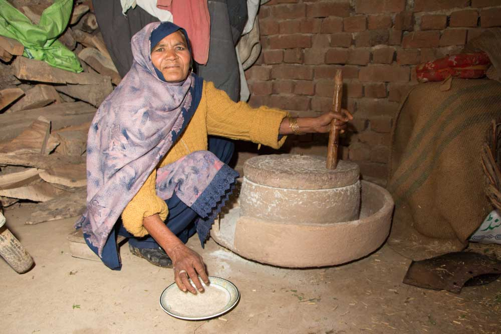 Woman grinding rice