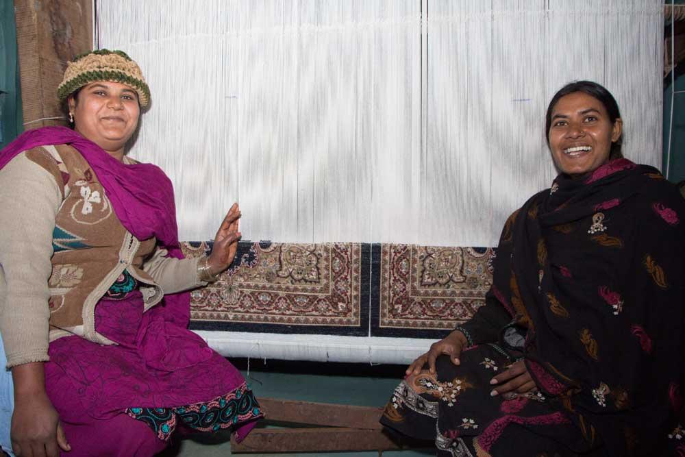 Fauzia and Sofia at their loom