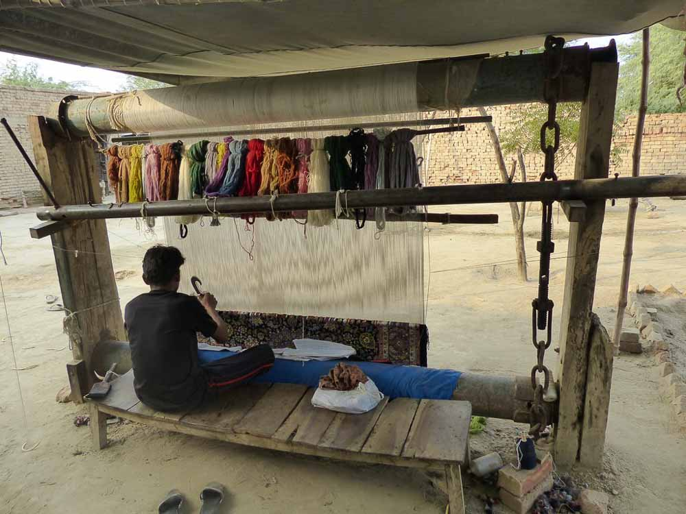 Md. Asif at work making a 4.5 x 7 foot Persian on his loom.