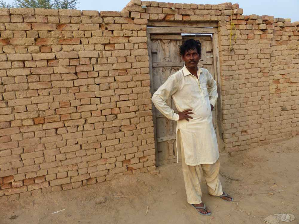 Ghulam Rasoom at his front gate.