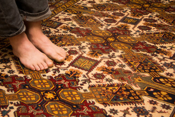 bare feet on bunyaad rug