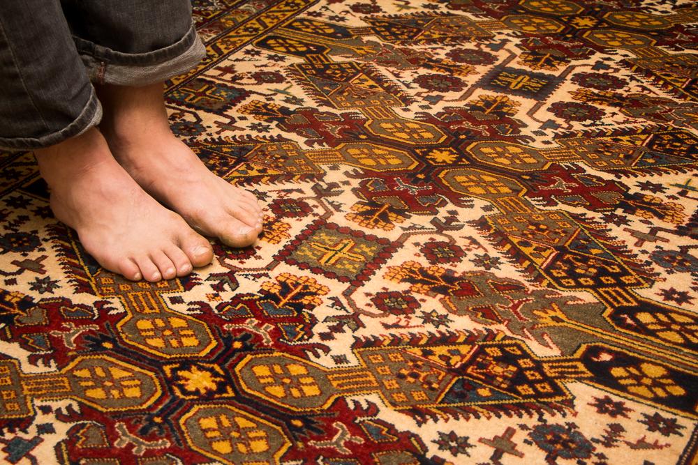 bare feet on bunyaad rug