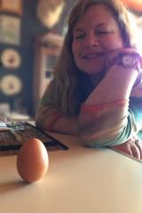Val balancing an egg