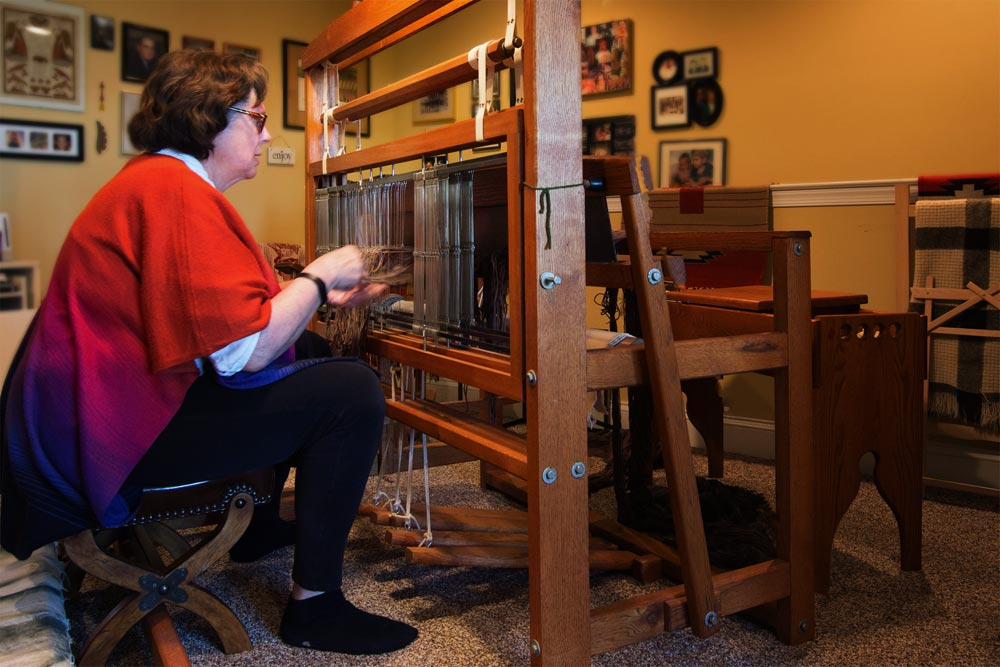 Nancy Chapman at setting up her loom to weave a scarf.